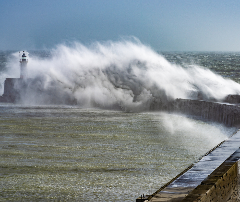 Storm surge with waves coming up to the top of the lighthouse in the Hamptons, NY.
