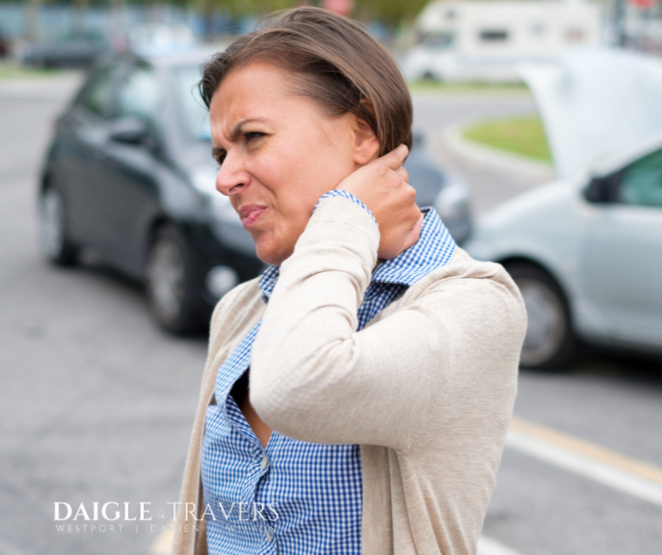 Southport CT women braces neck outside of car accident. She is about to find out that there was a lapse in her insurance coverage and she will be paying out of pocket for the damages.